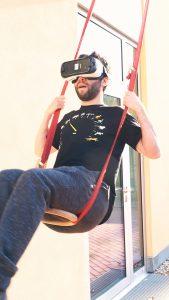 Guy on a hammock wearing a virtual helmet